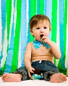 stock photo of bow-legged  - Child with blue bow - JPG