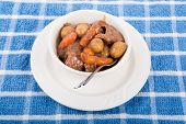 Beef Stew In White Bowl On Blue Towel