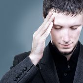Man is touching his head, migraine