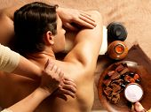 Masseur doing massage of backbone on man body in the spa salon. Beauty treatment concept.