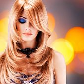 Beautiful pretty woman with long red hairs. Portrait  of young fashion model with blue eye makeup