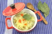 foto of cruciferous  - fresh cabbage with carrots and bay leaf - JPG