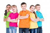 Group of smiling children with crossed arms in colorful t-shirts standing together on white backgrou