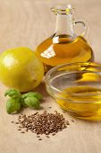 stock photo of flax seed oil  - Bottle of flax seed oil ready to use for a dressing - JPG