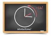 detailed illustration of a blackboard with daylight saving clock for wintertime, eps10 vector, gradi