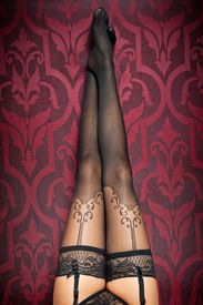 pic of legs apart  - Long legs in black stockings and panties indoor shot - JPG