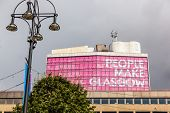 Glasgow, Scotland, UK - 23 August 2014: People make Glasgow - sign on a building on George Square, Glasgow.
