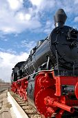 stock photo of freightliner  - Old Red Steam Locomotive in Tulcea Romania - JPG
