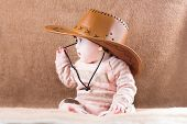 picture of baby cowboy  - Sweet Little Baby Girl In A Cowgirl Outfit