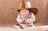 stock photo of baby cowboy  - Funny Baby In A Big Cowboy Hat