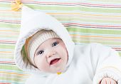 Sweet Smiling Baby In A Funny Hood