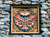Bhutan Traditional Wooden Decoration In Rock Wall