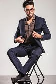 stock photo of button down shirt  - Fashion man in leather jacket looking down - JPG