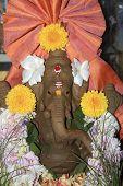 Flower Studded Ganesha Idol