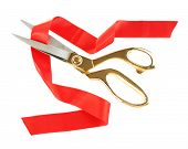 Red ribbon and scissors isolated on white