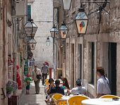 DUBROVNIK, CROATIA - MAY 27, 2014: Tourists sitting on terrace of Dolce Vita, one of the most popula