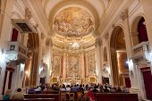 DUBROVNIK, CROATIA - MAY 28, 2014: People on mass in Jesuit church of St. Ignatius. The church and c