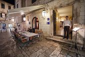 DUBROVNIK, CROATIA - MAY 27, 2014: Waiter standing at the entrance of Proto restaurant. Dubrovnik ha