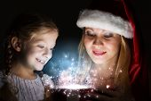 Happy daughter receiving Christmas gift from mother