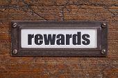 rewards - file cabinet label, bronze holder against grunge and scratched wood