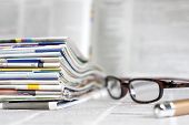Newspapers and magazines with glasses