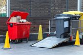 stock photo of dumpster  - Collecting dumpsters with garbage for recycling trash - JPG