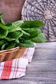 picture of sorrel  - Fresh sorrel in round wicker basket on napkin on wooden background - JPG