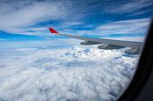 Spectacular view from  an airplane's window, offering a view of lovely clouds and blue sky while tra