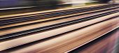 image of high-speed train  - Train rails seen from a mooving train at high speed - JPG