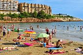 SALOU, SPAIN - AUGUST 29:  Vacationers in Capellans beach on August 29, 2014 in Salou, Spain. Salou
