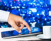 Business Man Touch Digital Tablet On Business Newspaper Near Window