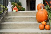 Pumpkins on front steps of home during Halloween / Thanksgiving season
