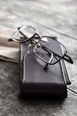 Old Eyeglasses On The Wooden Table