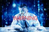 The word warning and mature businessman examining with magnifying glass against lines of blue blurre