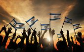 pic of eastern culture  - Silhouettes of People Holding Flag of Israel - JPG
