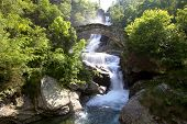 Stone Bridge and Waterfall