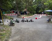 image of four-wheelers  - a field for kid atv racing in a zoo