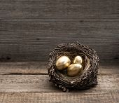 Golden Easter Eggs On Wooden Background