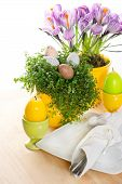 Easter Table Setting With Flowers, Eggs And Candles