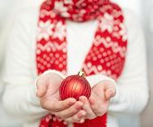 Decorative xmas toy ball on female hands