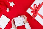 Giftboxes, Santa cap, picture of snowflake and toy star