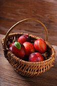 Fresh Plums In A Wicker Basket