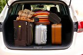 picture of heavy bag  - Suitcases and bags in trunk of car ready to depart for holidays - JPG