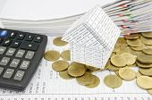 House On Pile Gold Coins With Calculator