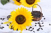 Sunflowers with seeds on table close-up