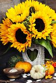 Sunflowers and Autumn decorations on wooden background