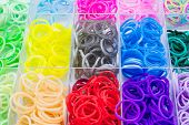 pic of loom  - Colorful of elastic rainbow loom on white background - JPG
