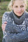 Autumn girl wearing sweater outdoor
