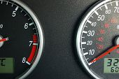 picture of speedo  - A view of a car instrument panel showing speedometer and rev counter - JPG