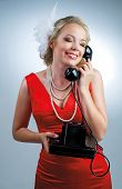 beautiful young blond woman with a telephone, retro style